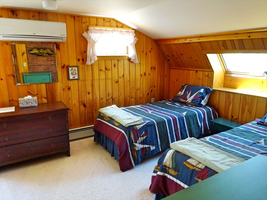 2nd floor bedroom with AC unit and 2 twins