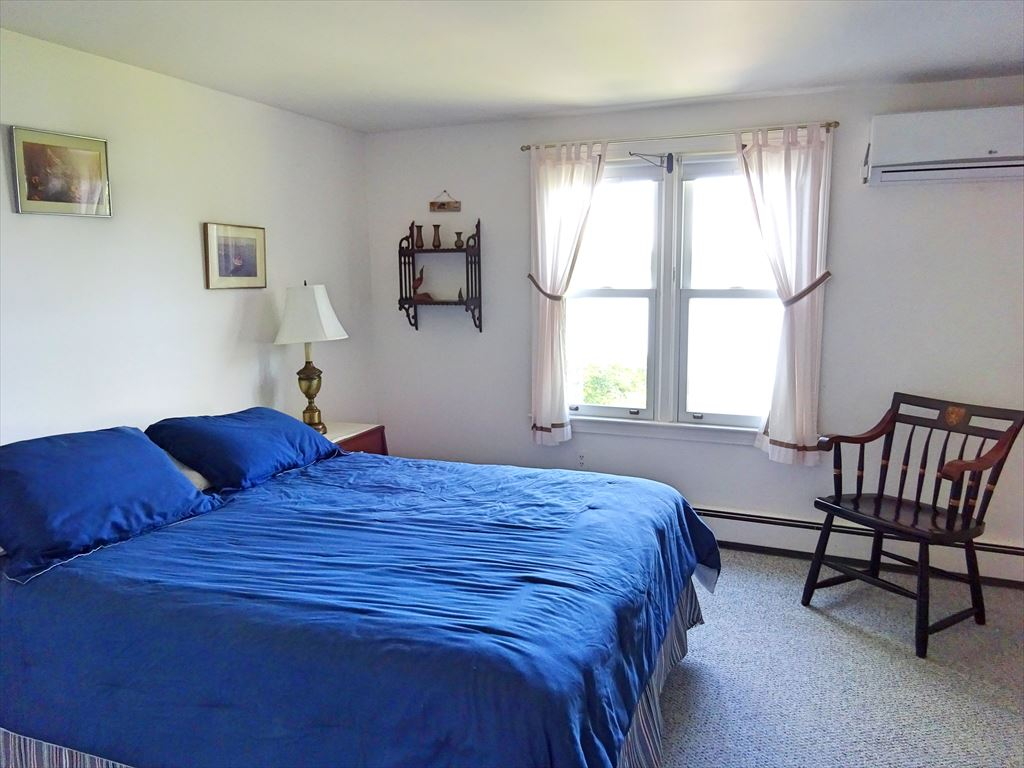First floor bedroom with queen with AC unit