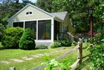 Front of house with screened porch