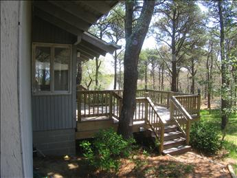 Back side of home with larger deck