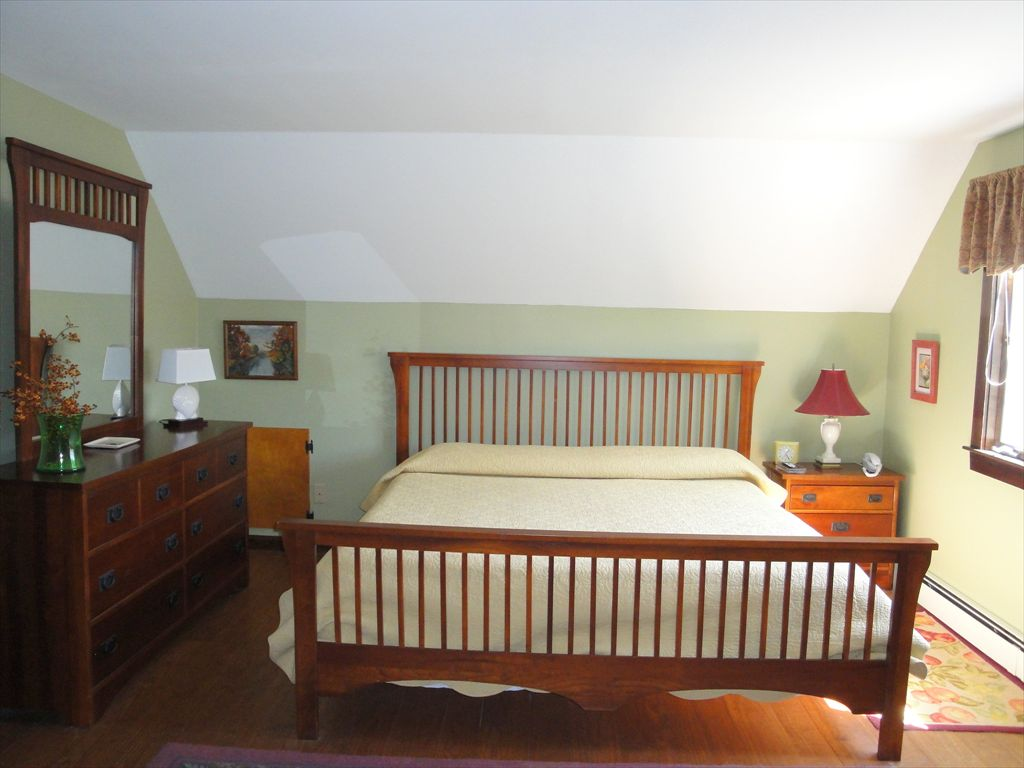 Upstairs Bedroom with King and ac wall unit and Flat screen TV