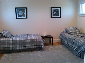 guest room with two twins and half bath just of 2nd floor open den to deck.