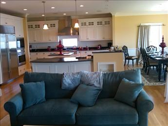 Open living, dining and gourmet kitchen with doors deck down to yard