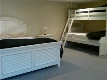 Basement sleeping 4-6 additional guests - TV area and extra fridge- other side has two futons