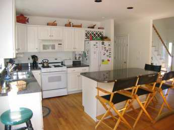 Open Kitchen with Island and Granite Counter tops