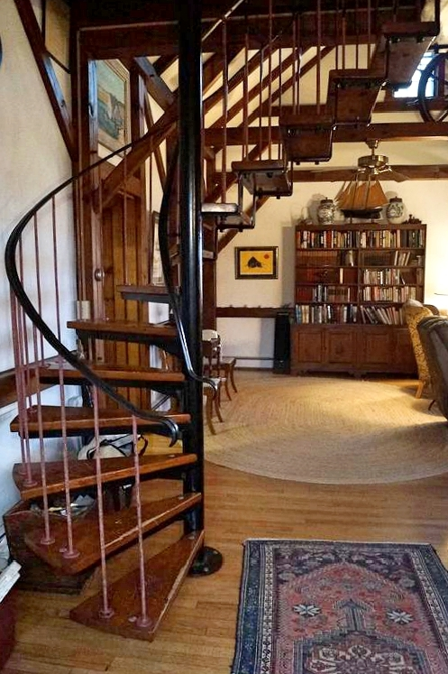 Custom-made winding stair to upper guest room and balcony