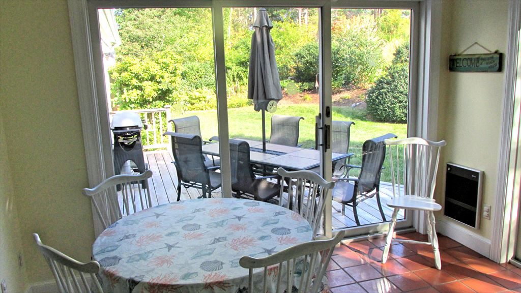 Sun room off the living area- opens to deck and back yard