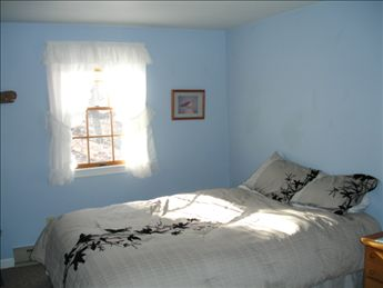 2nd floor bedroom with queen bed