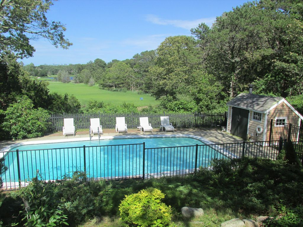 View of deck, pool and Fields Cove from french doors