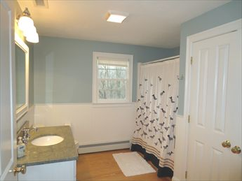 First floor bath with stackable washer & dryer