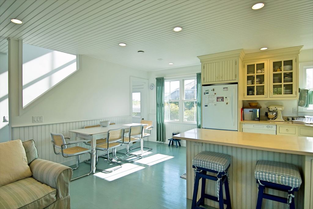 Another view of kitchen with dining area