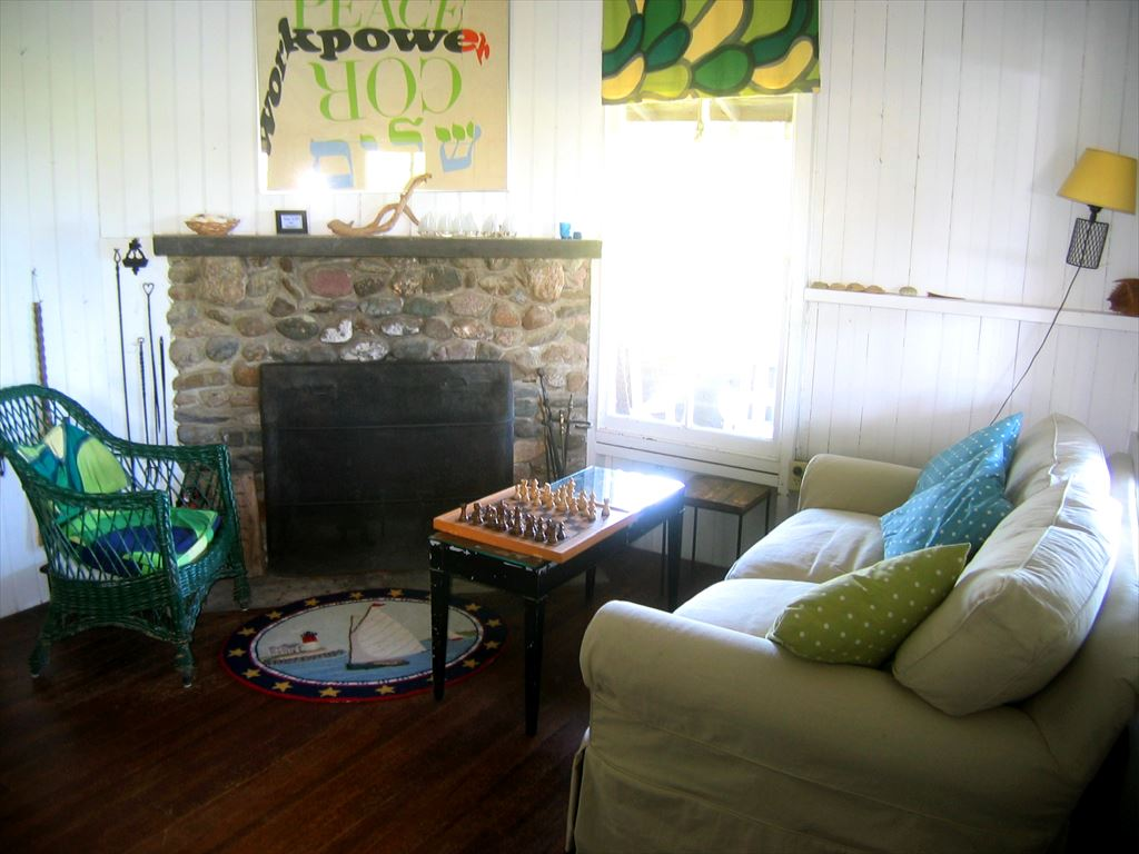 seating area in original cottage with stone fireplace
