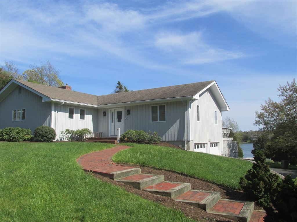 Front of home with views of Meeting House pond