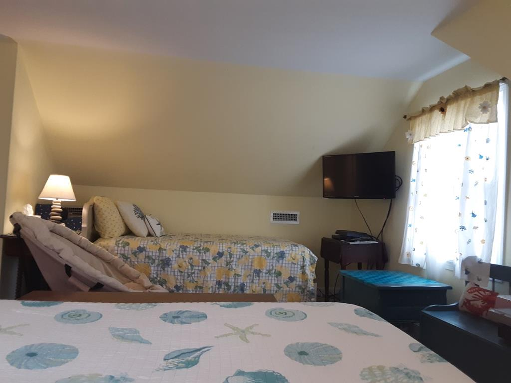 second floor third bedroom with TV