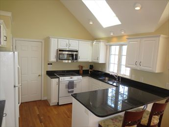 Lovely kitchen open to dining room & sunroom