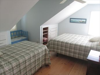 2nd floor bedroom with 1 twin and 1 queen
