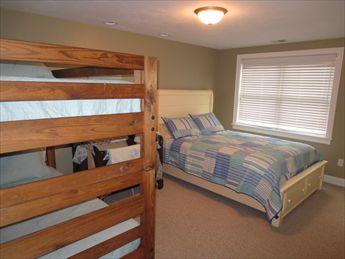 Queen bedroom %353 with set of bunks