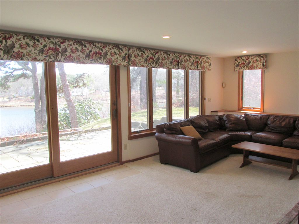 Another family room view showing patio and waterview
