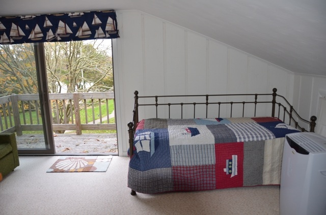 another bunk room view showing day bed/trundle and 2nd floor deck