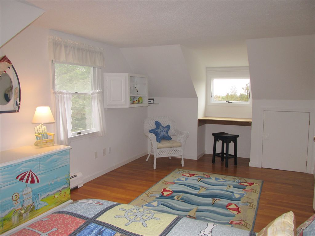 Another view of upstairs bedrooom, dormer window has peeks of Nauset Beach