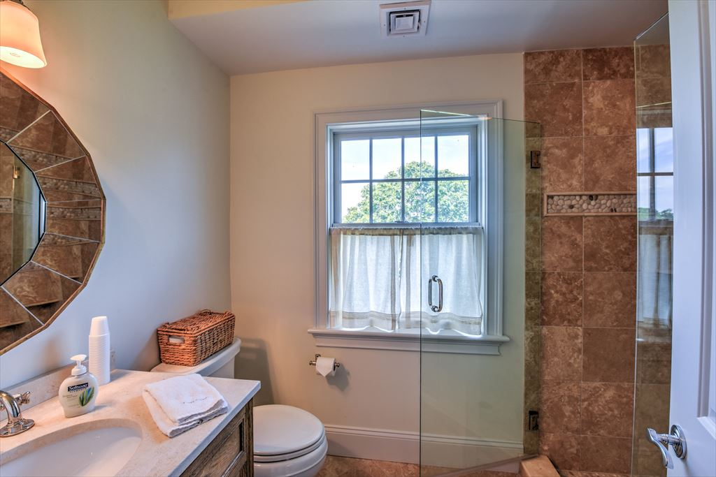 first level full bath with walk-in glass shower