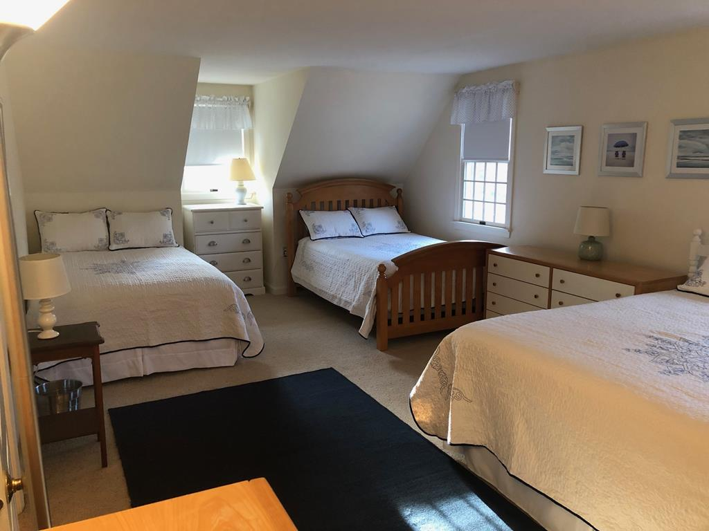 Large Bedroom with 2 Full Beds and 2 Twin Beds together to make a King