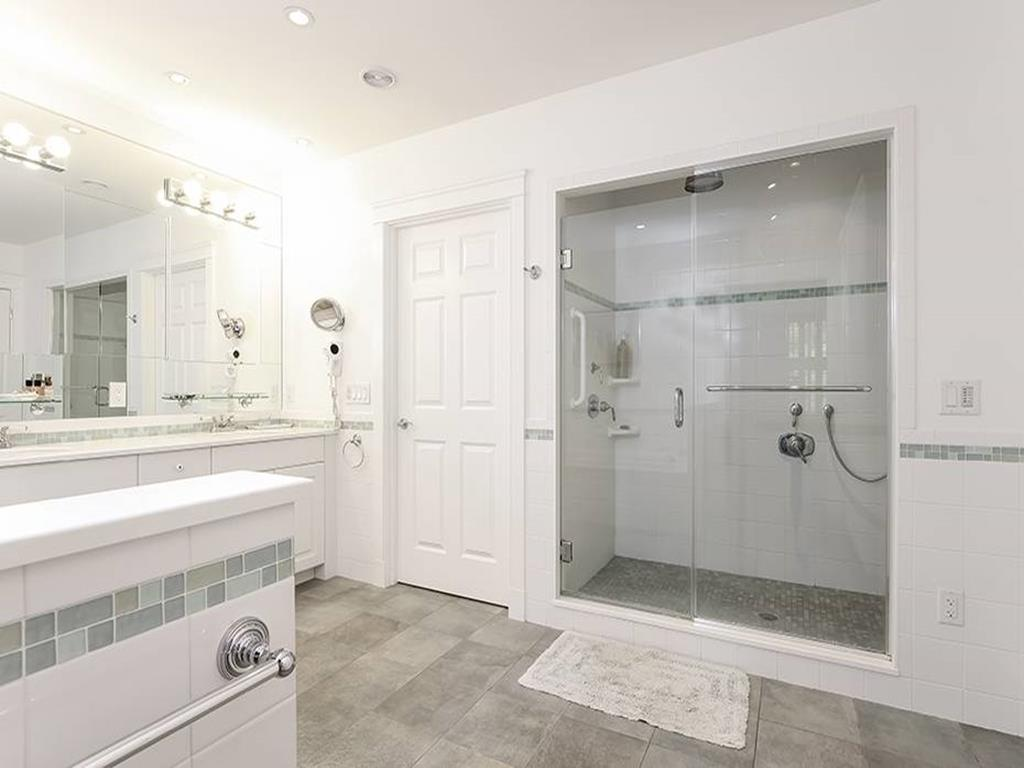 master bath with jetted tub and walk in shower